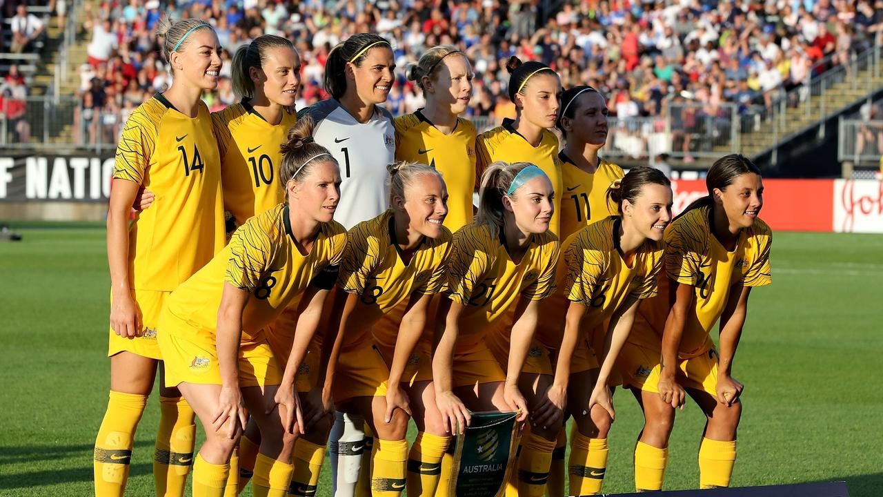 The Matildas pose for a picture before the match against the United States.