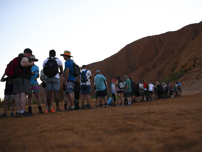 Tourists are seen lining up to climb Uluru, at Uluru-Kata Tjuta National Park in the Northern Territory on October 12. Picture: Lukas Coch/AAP