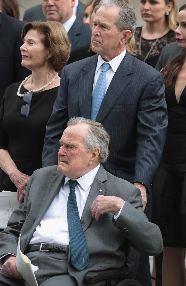 Former president George H.W. Bush with his son former president George W. Bush and former first lady Laura Bush. Picture: AFP