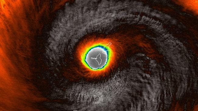 A false-colour satellite image provided by the National Oceanic and Atmospheric Administration (NOAA) shows the moment the eye of Super Typhoon Yutu passed over Tinian, one of three main islands in the U.S. Commonwealth of the Northern Mariana Islands. Picture: NOAA via AP