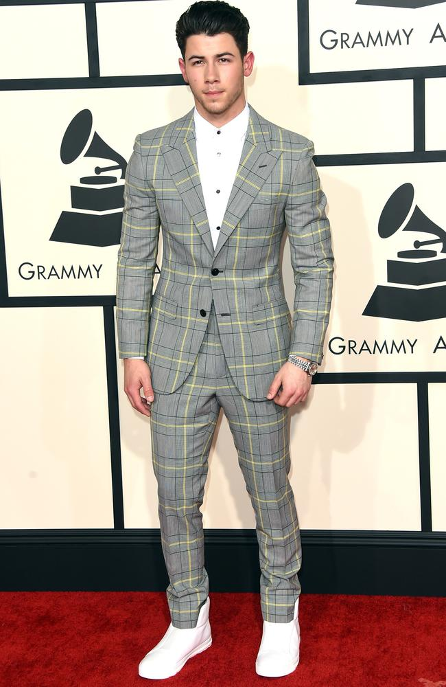 Nick Jonas opted for a grey, yellow, white and black suit. Hmmm ...