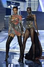 SHANGHAI, CHINA - NOVEMBER 20: Models Herieth Paul and Grace Bol walk the runway during the 2017 Victoria's Secret Fashion Show In Shanghai at Mercedes-Benz Arena on November 20, 2017 in Shanghai, China. (Photo by Frazer Harrison/Getty Images for Victoria's Secret)