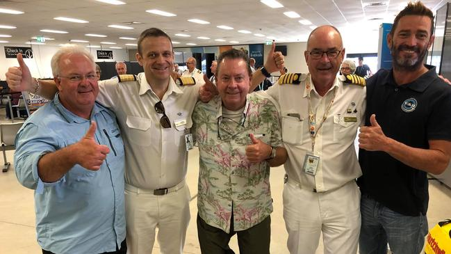 Chris Doran (L), Kevin Doran (C), Captain Alan Dockeray (2nd R) and Ben Johnson (R). Picture: P&O Cruises Australia.