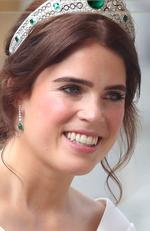 Newlywed Princess Eugenie of York smiles from her carriage after her Royal wedding to Mr. Jack Brooksbank at St. George's Chapel on October 12, 2018 in Windsor, England. (Photo by Chris Jackson/Getty Images)