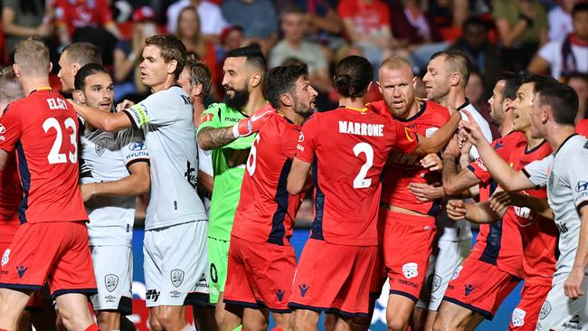 Players from Brisbane Roar and Adelaide United scuffle on Friday night. Picture: AAP