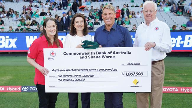 Shane Warne with Red Cross volunteer Anna Moriarty (left) Monique Macleod of the Commonwealth Bank of Australia and Ross Pinney, President of the Australian Red Cross.