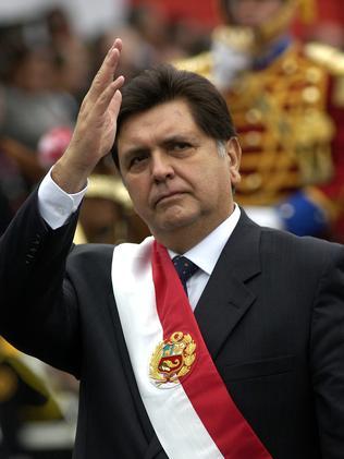 Former Peruvian President Alan Garcia waves to supporters. Picture: Karel Navarro/AP