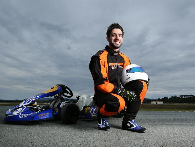 Courier-turned-race car driver Matthew Simmons. Picture: Luke Marsden