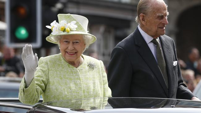 Happy Birthday Britains Queen Elizabeth II Waves To The Crowds As She Rides With Prince Phillip In An Open Top Car Celebrates Her 90th