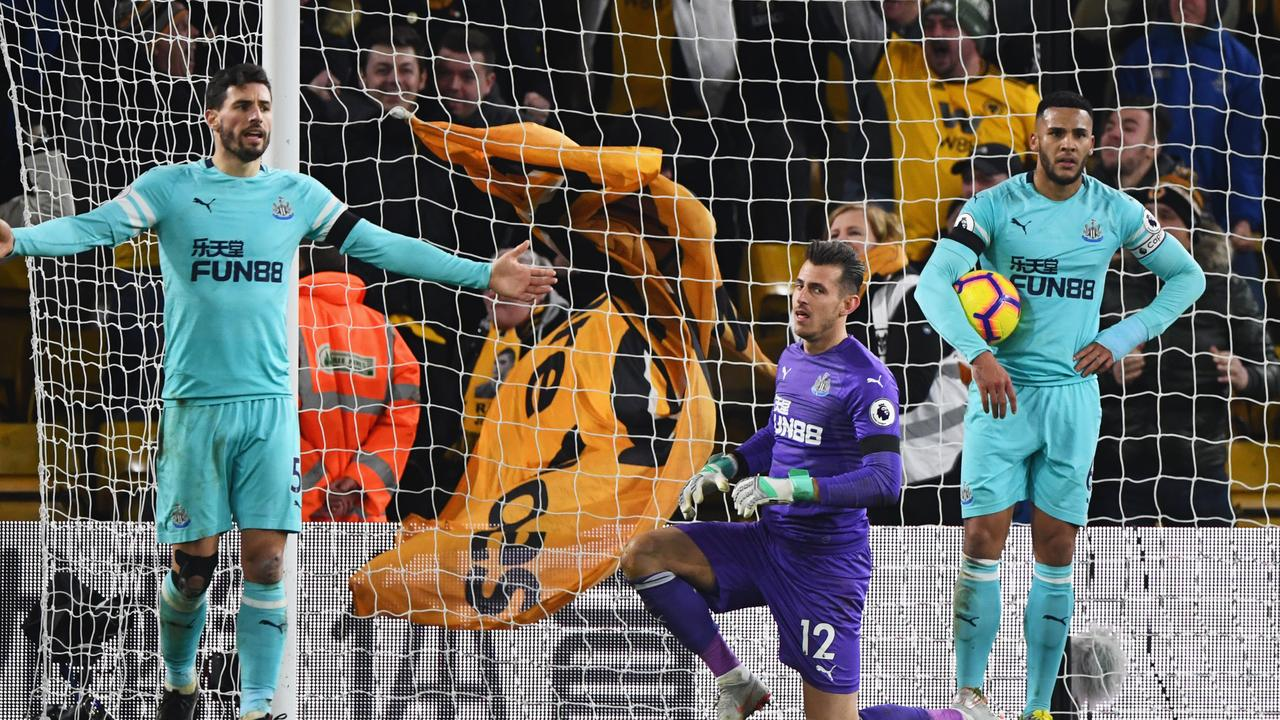Fabian Schaer, Martin Dubravka, Jamaal Lascelles and Florian Lejeune of Newcastle United react as Willy Boly of Wolverhampton Wanderers scores.