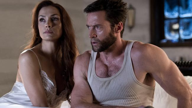 Bang for our buck ... Famke Janssen with Hugh Jackman in The Wolverine. Picture: Supplied.