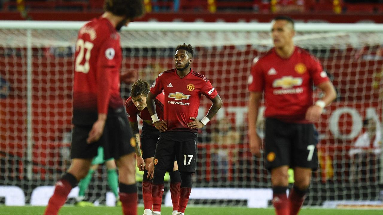 Manchester United's Brazilian midfielder Fred casts a dejected figure after the loss to Spurs.