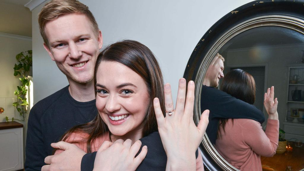Tessa Lomman with her affordable engagement ring and her husband Joel.