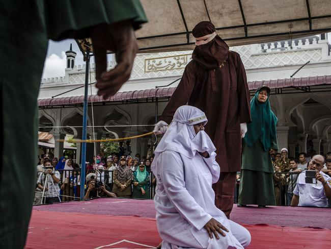 A woman in Aceh gets caning in public for spending time with a man who is not her husband, which is in violation against sharia law. Picture: Ulet Ifansasti/Getty Images