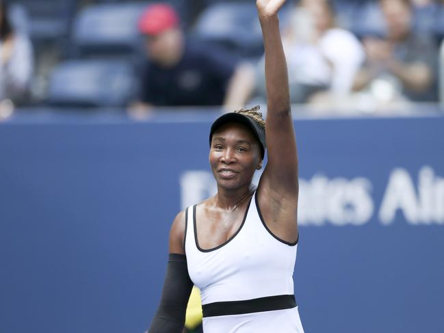 Venus Williams waves to the crowd after a stunning performance.