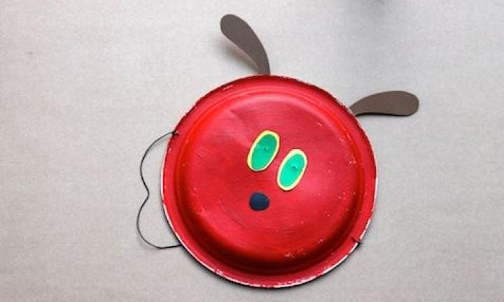 "7. Make like a Very Hungry Caterpillar  <p>Another paper plate specialty. Paint it red. Add some green circles for eyes, pop on a green onesie or whatever green clothes you can find and you're there.<a href=""http://www.kidspot.com.au/things-to-do/activities/the-very-hungry-caterpillar-mask"">See here for how to make a Very Hungry Caterpillar mask.</a></p>"