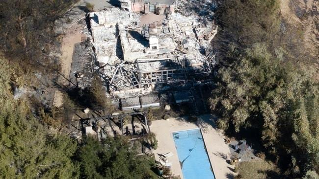 Liam Hemsworth's Malibu home was completely destroyed by the Woolsey fire in 2018. Miley's home next door survived the fires. Picture: Backgrid.