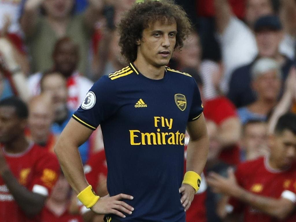 Arsenal's David Luiz stands on the pitch after Liverpool's Mohamed Salah scored his sides second goal during the English Premier League soccer match between Liverpool and Arsenal at Anfield stadium in Liverpool, England, Saturday, Aug. 24, 2019. (AP Photo/Rui Vieira)