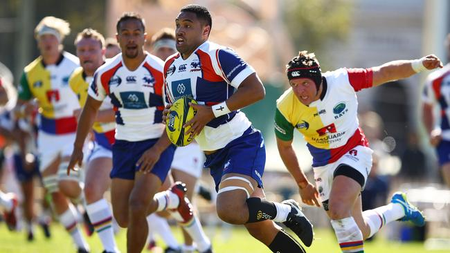 Tupou Sopoaga of the Rams breaks the Rays defence during the round one NRC match.