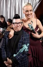 Lea DeLaria and Taylor Schilling, winners of the Outstanding Ensemble in a Comedy Series award for 'Orange Is the New Black,' pose in the press room during The 23rd Annual Screen Actors Guild Awards. Picture: Getty