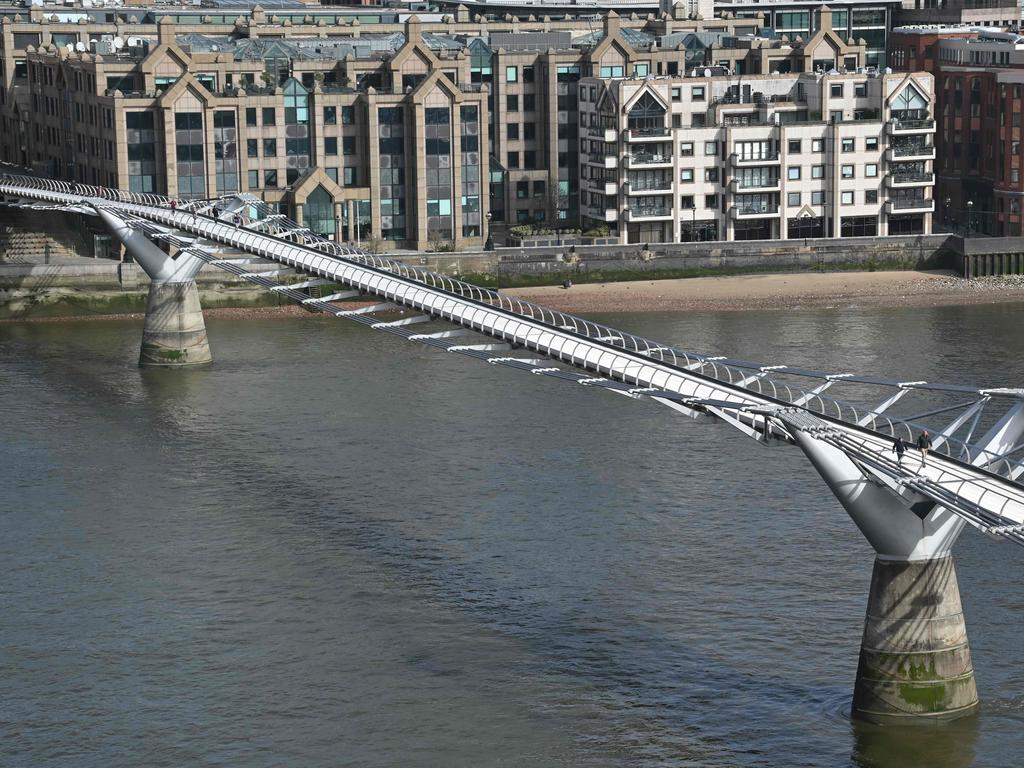 The normally busy Millennium footbridge across the Thames in London is deserted. Picture: AFP