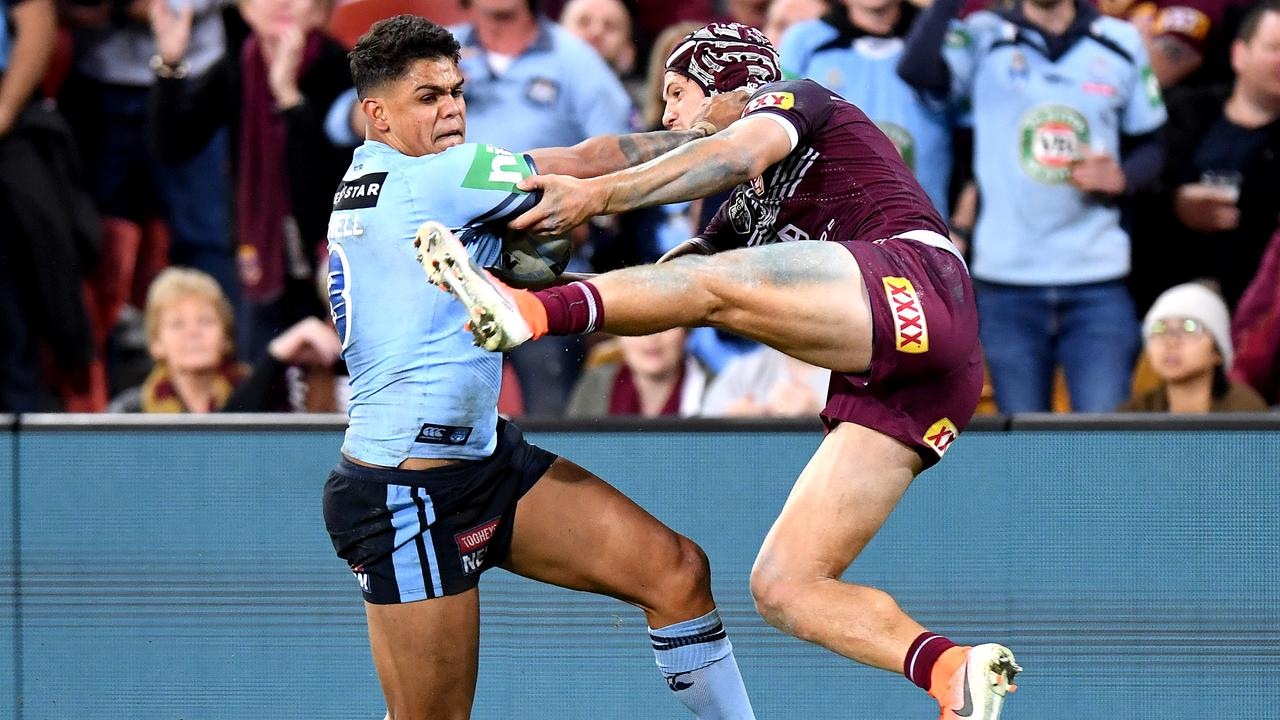 Kalyn Ponga tackles Latrell Mitchell in the 2019 Origin series opener.