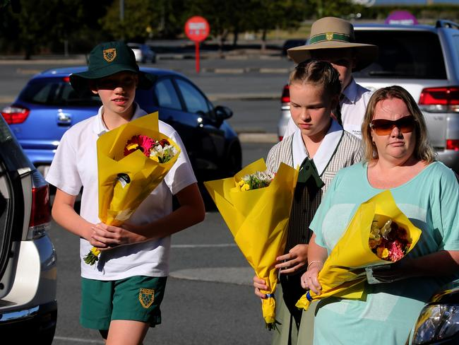 Students arrive to lay a tribute to the four victims. Photo: David Clark