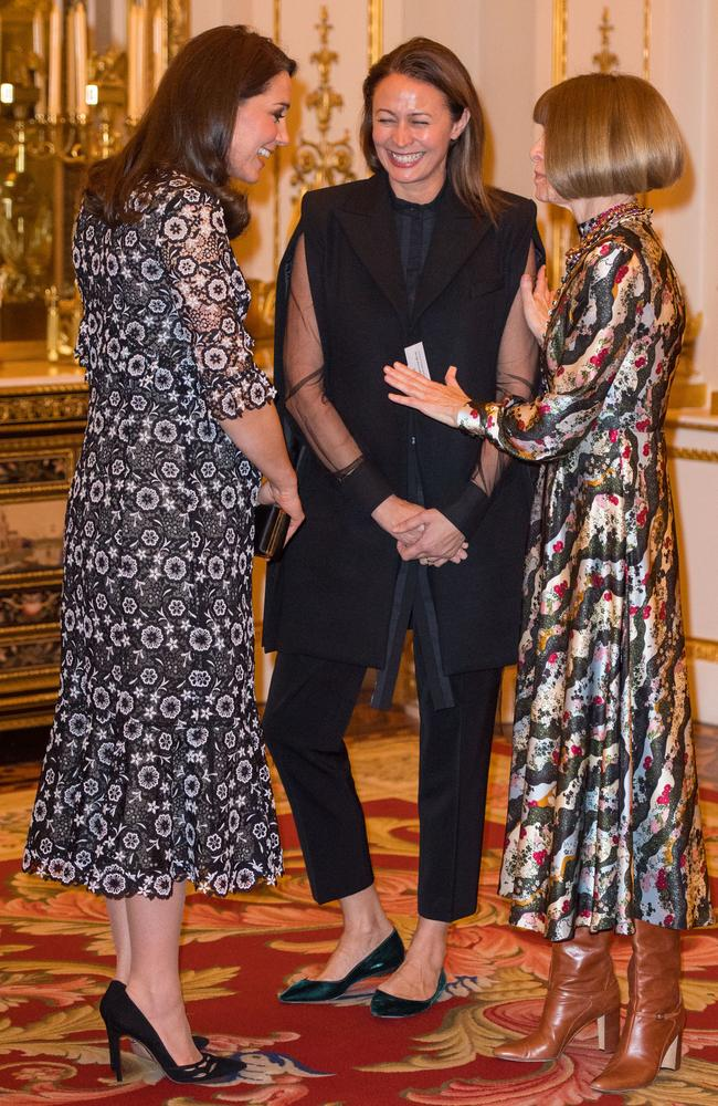Catherine, Duchess of Cambridge shares a laugh with the Chief Executive of the British Fashion Council Caroline Rush and Vogue editor Anna Wintour. Picture: Dominic Lipinski — Pool/Getty Images