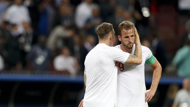 Harry Kane and England's Eric Dier react at the end of the semifinal match between Croatia and England.