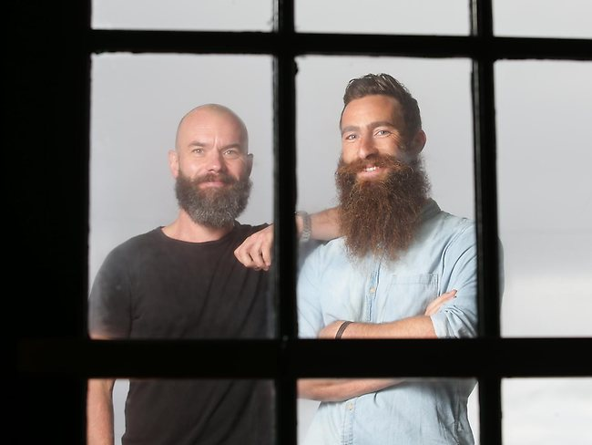 This Is Beard: Jimmy Niggles has grown one of the most impressively rugged beards in Australia to raise awareness of melanoma. Niggles (right) pictured with photographer friend Brock Elbank. Picture: Cameron Richardson