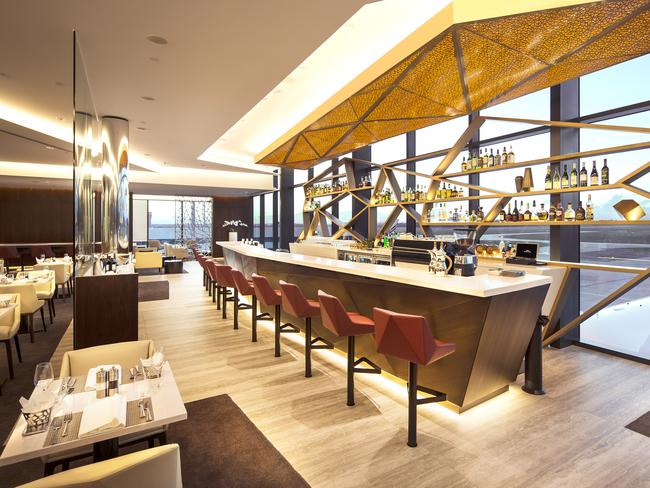 The bar at The House in Melbourne, overlooking the runways.