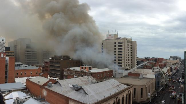 The fire caused thick plumes of acrid smoke to blanket parts of the CBD. Picture: Roy VanDerVegt
