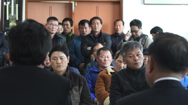 Lawmakers, left and right, meet with salt farm owners and workers as a part of human rights inspection on Sinui Island, South Korea. (AP Photo/Ahn Young-joon)