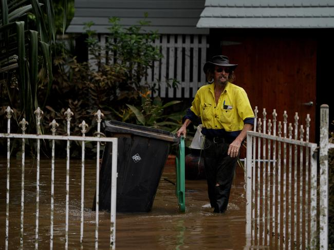 Residents clean up their property as floodwaters recede in Lismore, New South Wales. Picture: AAP