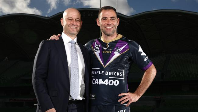 Cameron Smith (R) of the Storm and NRL CEO Todd Greenberg ahead of Smith's 400th NRL game.