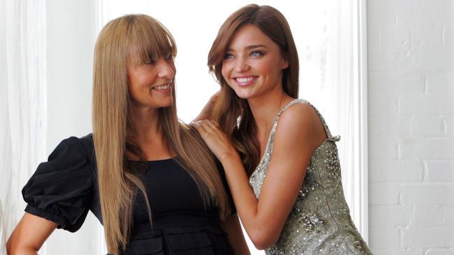 Designer Collette Dinnigan with model Miranda Kerr, waaay back in 2008 at CD's studio in Sydney.
