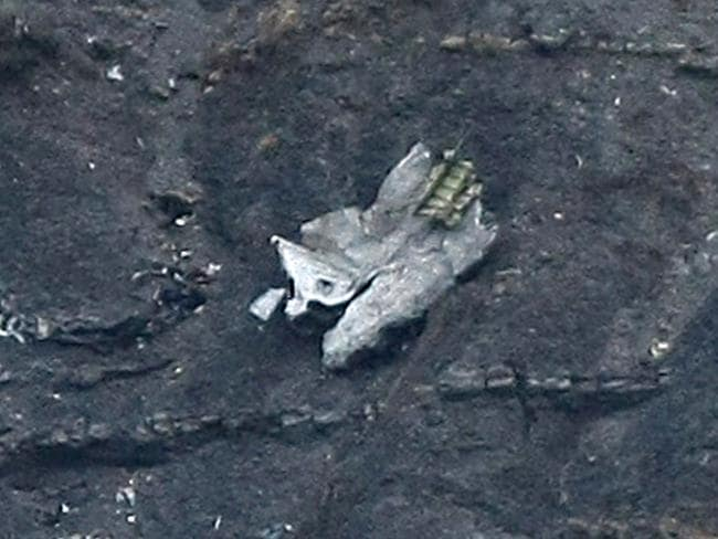 Pieces left ... debris of the crashed Germanwings passenger jet is scattered on the mountain. Picture: AP