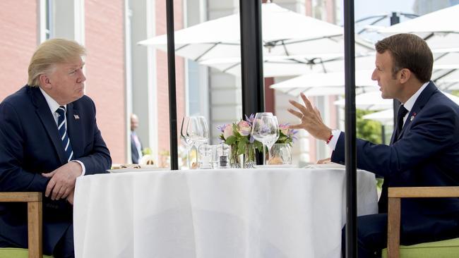 Donald Trump listening to Emmanuel Macron. Picture: AP/Andrew Harnik