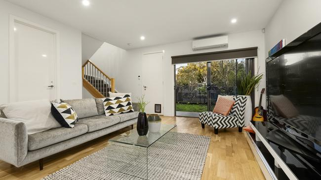 The home's interior is light and bright with an open-plan living zone downstairs.