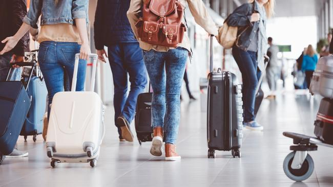 Anything more than a carry-on bag can cause some serious damage to your wallet when travelling with budget airlines. Picture: iStock