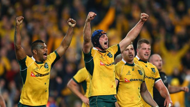 Kurtley Beale and Dean Mumm of the Wallabies celebrate beating the All Blacks at ANZ Stadium.