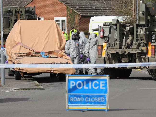 Forensic teams work at an address in Dorset as they remove a recovery truck used following the Salisbury nerve agent attack. Picture: Christopher Furlong/Getty Images