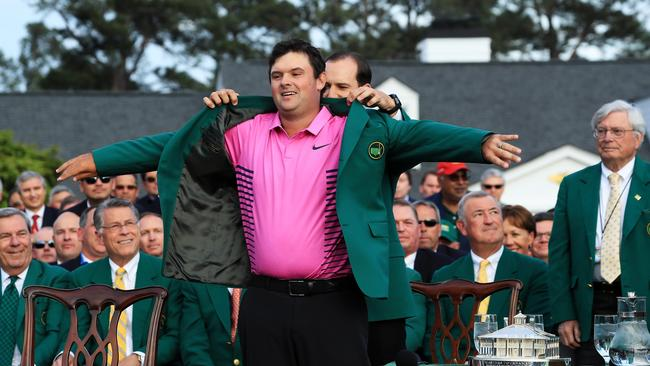 Last year's winner Sergio Garcia presents PAtrick Reed with his green jacket.