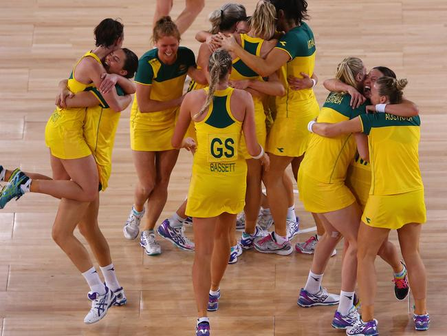 The Australian team celebrate victory in the gold medal netball match.