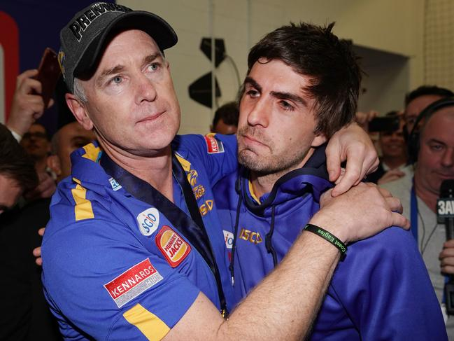 Andrew Gaff consoled by coach Adam Simpson after he copped his own gut punch, missing out on the Eagles' flag.