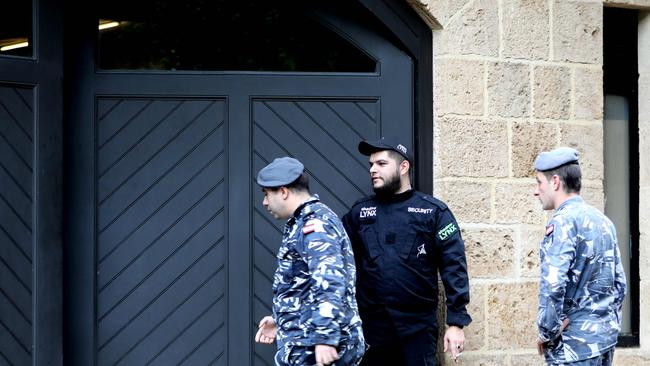 Members of the Lebanon's security forces stand at the parking gate of the house identified by court documents as belonging to former Nissan chief Carlos Ghosn in a wealthy neighbourhood of the Lebanese capital Beirut. Picture: Anwar Amro, AFP.