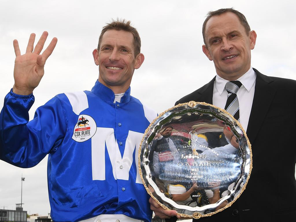 Jockey Hugh Bowman (left) and trainer Chris Waller aare seen with the Cox Plate after Bowman rode Winx to victory in race 9, the Cox Plate Day at Moonee Valley Racecourse in Melbourne, Saturday, October 27, 2018. (AAP Image/Julian Smith) NO ARCHIVING, EDITORIAL USE ONLY