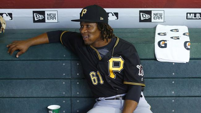 Pittsburgh Pirates' Gift Ngoepe, of South Africa, sits in the dugout prior to a baseball game.