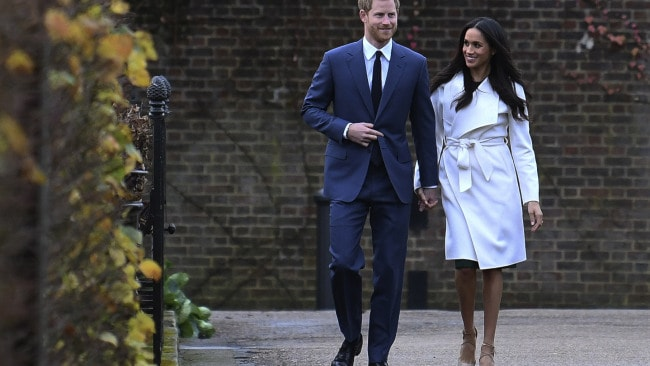 Prince Harry and actress Meghan Markle attend an official photocall to announce their engagement at The Sunken Gardens at Kensington Palace. Photo: Steve Back/Getty Images
