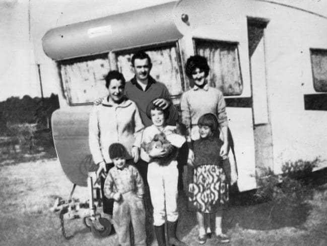 The Beaumont family with an unidentified woman by a caravan some time before the children's 1966 disappearance from Glenelg beach.